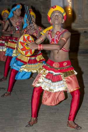 Dancers perfrom in Kandy, Sri Lanka during the Esala Perahera (great procession). The Esala Perahera is held to honour the sacred tooth relic of Lord Buddha.