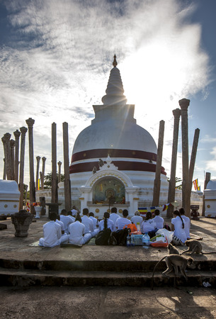 3rd ancient: Buddhist pilgrims worship in front of the Thuparama Dagoba at Anuradhapura in Sri Lanka. This dagoba is the oldest in Sri Lanka and was constructed by Devanampiya Tissa in the 3rd Century BC. It is surrounded by 41 ancient pillars.