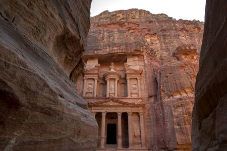 Late afternoon at the Treasury (Al-Khazneh) at the ancient site of Petra in Jordan. Carved out of iron-laden sandstone, it was built as a tomb by the Nabataeans in the 3rd century BC.