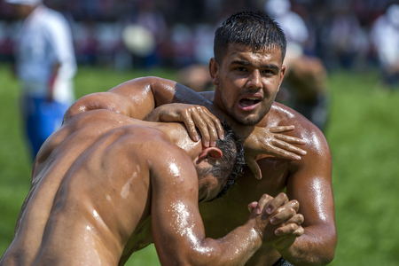 wrestlers: Wrestlers fight for  supremacy  during competition at the Kirkpinar Turkish Oil Wrestling Festival in Edirne in Turkey.