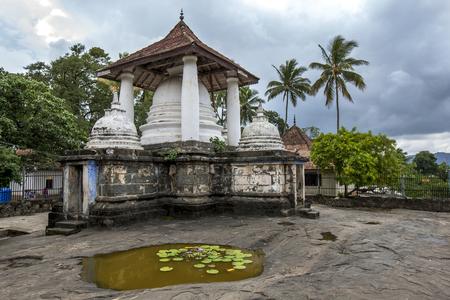 The stupa complex at the Gadaladeniya Raja Maha Vihara located at Diggala near Kandy in Sri Lanka. It was built by King Bhuwaneka Bahu IV in the year 1344. Stock Photo