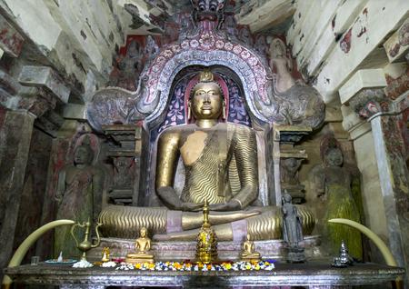A seated Buddha statue within the Image House at Gadaladeniya Raja Maha Vihara located at Diggala in Sri Lanka. Editorial