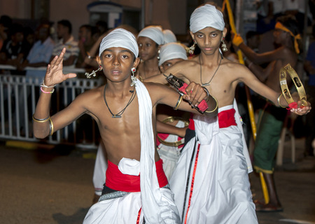 Tamerine Players perform along the streets of Kandy in Sri Lanka during the Esala Perahera. The Esala Perahera is held to honour the sacred tooth relic of Lord Buddha.