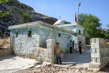 Kurdish boys stand outside a burial tomb in a small village near Samsat in eastern Turkey.
