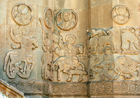 Stone carvings featuring mounted horsemen and various wild animals on the exterior wall of the Akdamar Killisesi (Church of the Holy Cross) on Akdamar Island on Lake Van in Turkey. This former Armenian church was built in 921 AD.