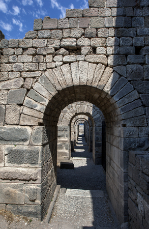 The arched stone doorways of the Trajaneum (temple) at the ancient site of Pergamum (Pergamon). Pergamum is located near the modern city of Bergama in Turkey.