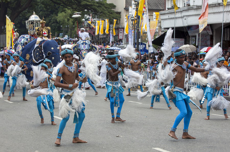 Chamara Dancers perform along a street in Kandy in Sri Lanka during the Day Perahera, the final parade of the Buddhist Esala Perahera (great procession). Editorial