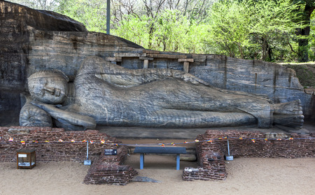 The reclining Buddha statue of Gal Vihara at the ancient site of Polonnaruwa in Sri Lanka. It is carved out of a single slab of granite rock.