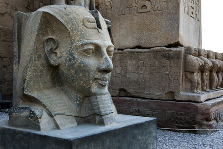 A giant stone bust depicting Pharaoh Ramesses ll located at the entrance pylon of the Luxor Temple (Temple of Amun-Ra) at Luxor in Egypt.