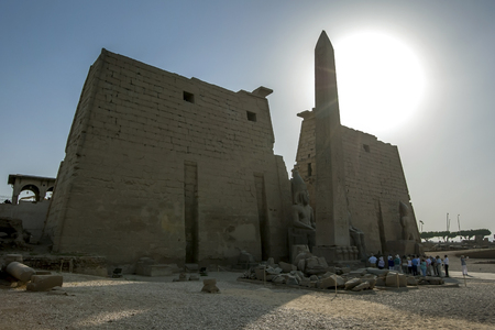 The entrance pylon of the Luxor Temple (Temple of Amun-Ra) at Luxor in Egypt. At the entrance stands the obelisk and two giant statues of Ramesses ll.
