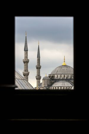 A view from a window  inside Aya Sofya, the former basilica Hagia Sophia of Constantinople looking towards the Blue Mosque (Sultan Ahmet Camii). Both buildings sit in Istanbul in Turkey.