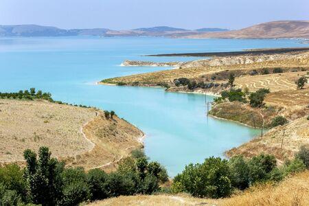 A paddock adjacent to Ataturk Dam (GAP) near Samsat in the Adiyaman Province of Turkey. On the right are paddocks of harvested grain crops.