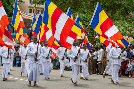 Buddhist Flag Bearers parade at the start of the Day Perahera, the final event of the Buddhist Esala Perahera festival at Kandy in Sri Lanka.