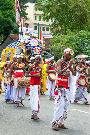 A  group of musicians perform ahead of a ceremonial elephant during the Day Perahera, the final parade of the Buddhist Esala Perahera festival at Kandy in Sri Lanka.