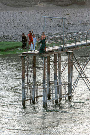 Egyptian boys stand on a water pumping jetty on the bank of the River Nile north of Esna Lock in Egypt. Editorial