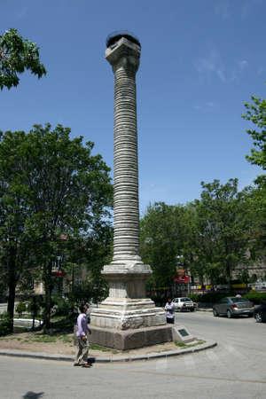 A man admires the Column of Julian at Ankara in Turkey, built in honour of Roman Emperor Julian the Apostate (AD 361 - 363). Editorial
