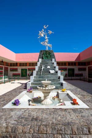 A memorial dedicated to World War Two featuring a fountain, stairs and dove statue at the entrance to El Alamein War Museum in northern Egypt. Editorial