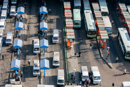 Rows of vehicles lined up in one of the many bus stations in downtown Cairo in Egypt. Editorial