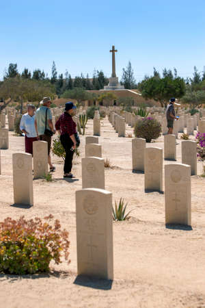 Tourists inspect Commonwealth war graves at El Alamein War Cemetery in northern Egypt. The cemetery contains the graves of British Empire soldiers who died during World War Two. Editorial