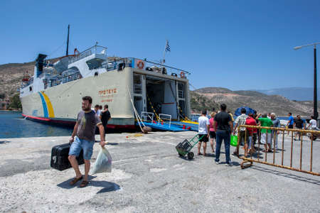 A passenger leaves a Greek ferry boat docked in the harbour on Kastellorizo Island (Meis) in Greece. The island is located only 2 kilometres from the Turkish coastline.