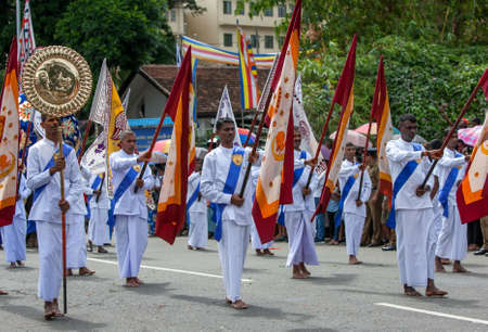 Flag Bearers perform during the Day Perahera, the final event of the Buddhist Esala Perahera at Kandy in Sri Lanka.