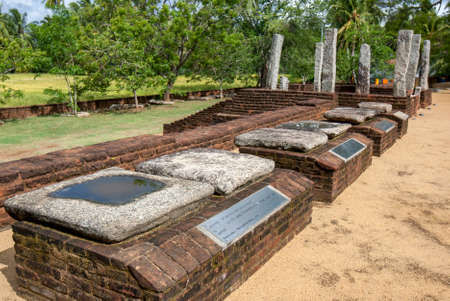 A row of flower alters on display at the Sandagiri Stupa at Tissamaharama, Sri Lanka. Buddhist worshippers placed flower offerings in the stone bowl.