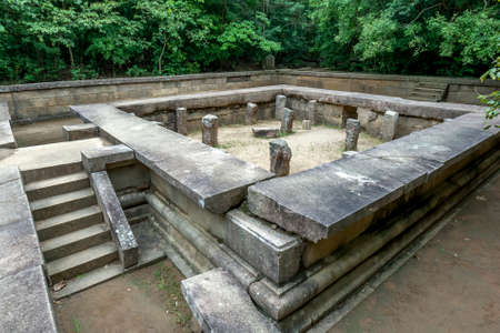 The ruins of a Padhanaghara, a double-platform stone structure, at the ancient Buddhist monastery site at Ritigala Strict Nature Reserve which dates to the 1st Century BC.
