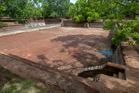 A tank (man-made water reservoir) within the former Royal Gardens of Sigiriya Rock Fortress. These gardens date from the 5th century.