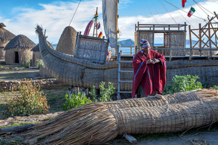 An Indian man explains how boats were constructed using bound reeds whilst giving a talk at the Huatajata Eco Village on Lake Titicaca in Bolivia. Editorial