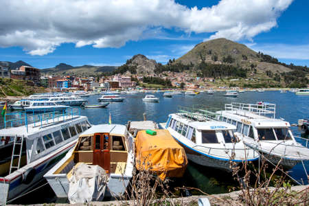 Boats docked in the harbour of Copacabana in Bolivia which lies on the shore of Lake  Titicaca.