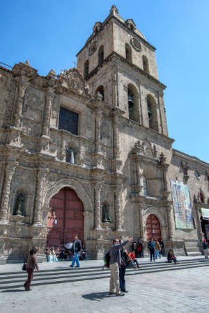 People gather outside the Basilica of San Francisco in Plaza San Francisco in La Paz in Bolivia. This impressive Catholic church was built between the 16th and 18th centuries.