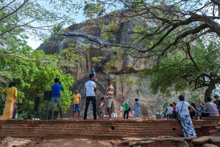 Visitors to Sigiriya Rock Fortress in central Sri Lanka stand on the Lions Platform below the stairway to the rocks summit.