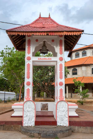 A Buddhist Bell Tower featuring guardstones and a moonstone entrance at the ancient site of Kataragama in southern Sri Lanka. Editorial