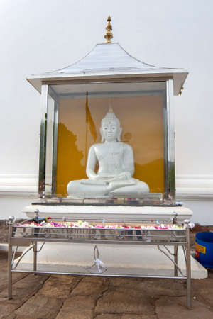 A Buddhist Shrine standing in front of  Kiri Vihara, a dagoba that dates back to the 1st century BC at the ancient site of Kataragama in southern Sri Lanka.