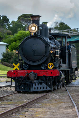 Engine RX 224, a 1915 built steam locomotive, prepares to connect to the Cockle Train at Goolwa station in South Australia, Australia. The train is run by the SteamRanger Heritage Railway.