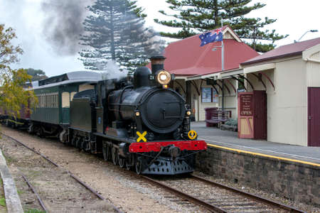 The Cockle Train driven by RX 224, a 1915 built steam locomotive, arrives at Port Elliot station in South Australia, Australia. The train is run by the SteamRanger Heritage Railway. Editorial