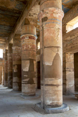 A row of  painted tent pole columns within the Festival Temple of Thutmose III, c. 1479-25 B.C. at Karnak Temple (Temple of Amun) at Luxor in Egypt.