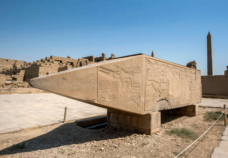 The upper section of the pink granite obelisk of Hatshepsut adjacent to the Sacred Lake at Karnak Temple (Great Temple of Amun) at Luxor in Egypt. Editorial