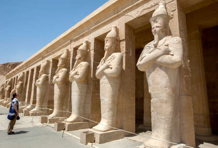 A tourist admires the row of Osiris pillars which stand along the upper terrace at the Mortuary Temple of Hatshepsut at Deir al-Bahri near Luxor in central Egypt.