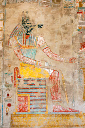 A relief depicting a seated Anubis, the canine (jackal) God of the Dead, at the Mortuary Temple of Hatshepsut at Deir al-Bahri near Luxor in central Egypt. Editorial