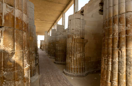 The stone carved columns of the Hypostyle Hall at the entrance to the Step Pyramid (Pyramid of Djoser) at Saqqara in northern Egypt.