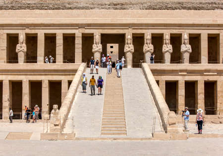LUXOR, EGYPT - MAY 05, 2013 : The Mortuary Temple of Hatshepsut including a row of Osiris pillars which stand along the upper terrace at Deir al-Bahri near Luxor in central Egypt. The temple was built by Queen Hatshepsut (1473- 1458BC) as a funerary monum
