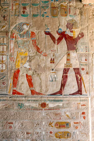 An engraved relief depicting Horus (left) receiving an offering from Thutmose lll at the Mortuary Temple of Hatshepsut at Deir al-Bahri near Luxor in central Egypt. Editorial