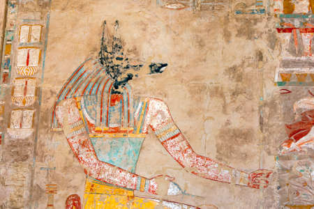 A relief depicting Anubis, the canine (jackal) God of the Dead, at the Mortuary Temple of Hatshepsut at Deir al-Bahri near Luxor in central Egypt. Editorial