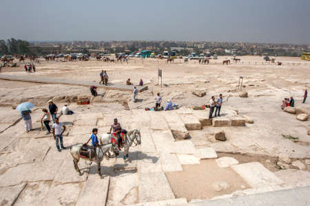A view from the base of the Pyramid of Khufu on the Giza Plateau looking towards modern Cairo in Egypt.