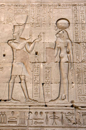 Engraved reliefs including one of lioness warrior goddess Sekhmet (right) and hieroglyphs on a wall inside the Temple of Horus at Edfu in central Egypt. She was seen as the protector of the pharaohs.