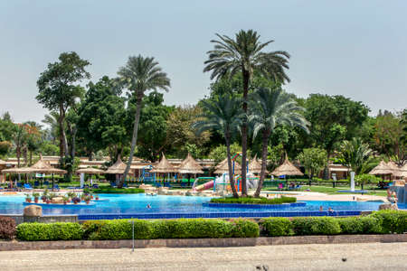 The luxury swimming pool of a hotel complex adjacent to the River Nile at Luxor in Egypt. Editorial