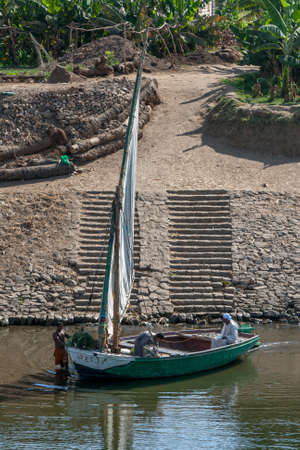 A sailing boat prepares to depart from the bank of the River Nile south of Luxor in Egypt. Editorial