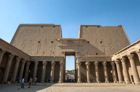 The 36 metre high pylon or gateway to the Temple of Horus as seen from the Court of Offerings at Edfu in central Egypt. Editorial