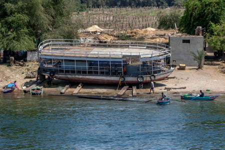 An abandoned passenger ferry sits on the bank of the River Nile south of Luxor in central Egypt.
